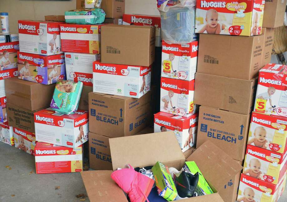 Some of the donations collected by 9-year-old Olivia Marin for victims of Hurricane Sandy in the garage of her Clifton Park home Wednesday Nov. 7, 2012.  (John Carl D'Annibale / Times Union) Photo: John Carl D'Annibale / 00020009A