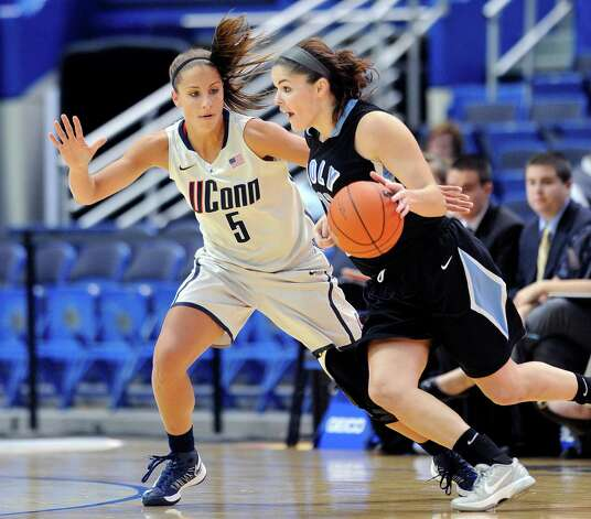 Connecticut's Caroline Doty, left, guards Holy Family's Molly Hanlon during the first half of an exhibition NCAA college basketball game in Hartford, Conn., on Wednesday, Nov. 7, 2012. (AP Photo/Fred Beckham) Photo: Fred Beckham, Associated Press / FR153656 AP