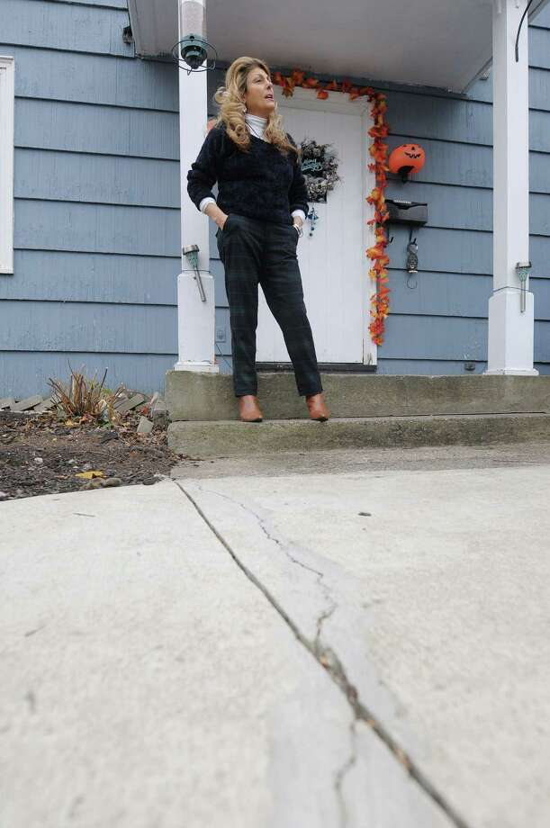 Nancy Beauregard outside her home on Wednesday, Nov. 7, 2012 in Rensselaer where poor construction work was done by a contractor laying concrete sidewalks. Beauregard won a court case through Guilderland Town Court against the contractor, but has been unable to collect the money. (Paul Buckowski / Times Union) Photo: Paul Buckowski / 00020004A