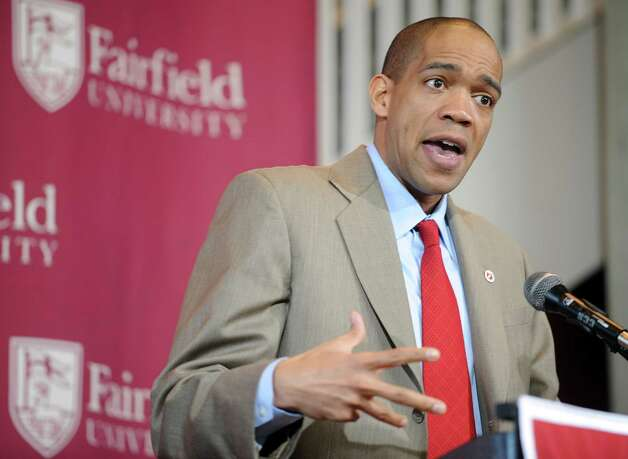 New Fairfield University men's basketball coach Sydney Johnson is introduced Wednesday April 6, 2011 at the John Barone Campus Center. Photo: Autumn Driscoll, ST / Connecticut Post