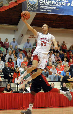 Fairfield University's #25 Colin Nickerson lays up the ball unopposed, during third round round CIT post season mens basketball tournament action against Robert Morris in Fairfield, Conn. on Wednesday March 21, 2012. Photo: Christian Abraham / Connecticut Post