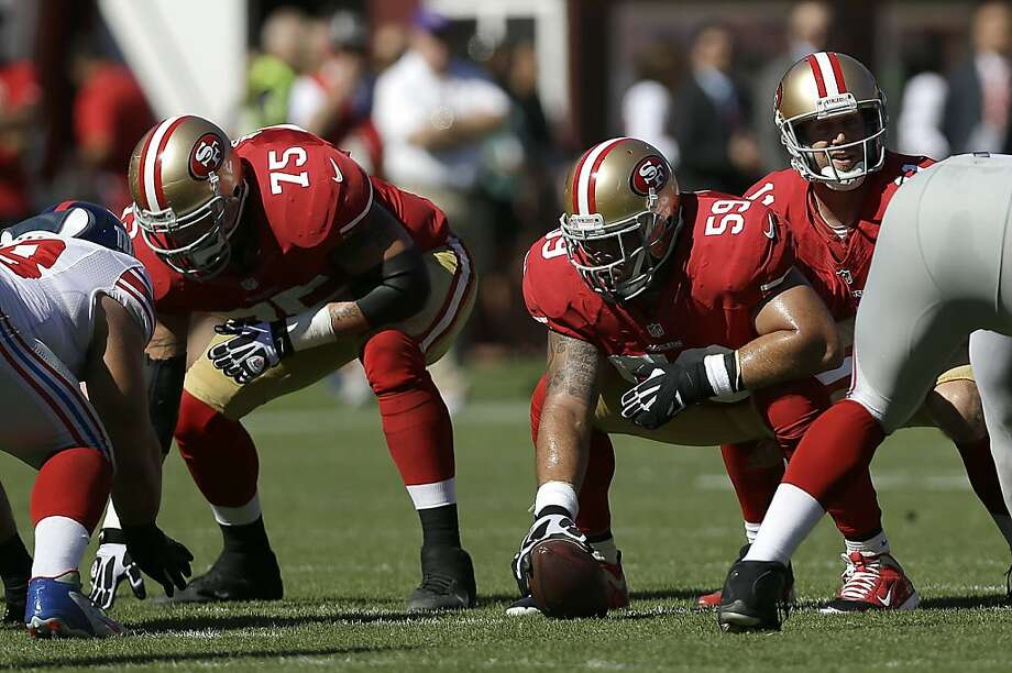 For guard Alex Boone (75), center Jonathan Goodwin is often a beacon as the 49ers' offensive line matures. Photo: Marcio Jose Sanchez, Associated Press