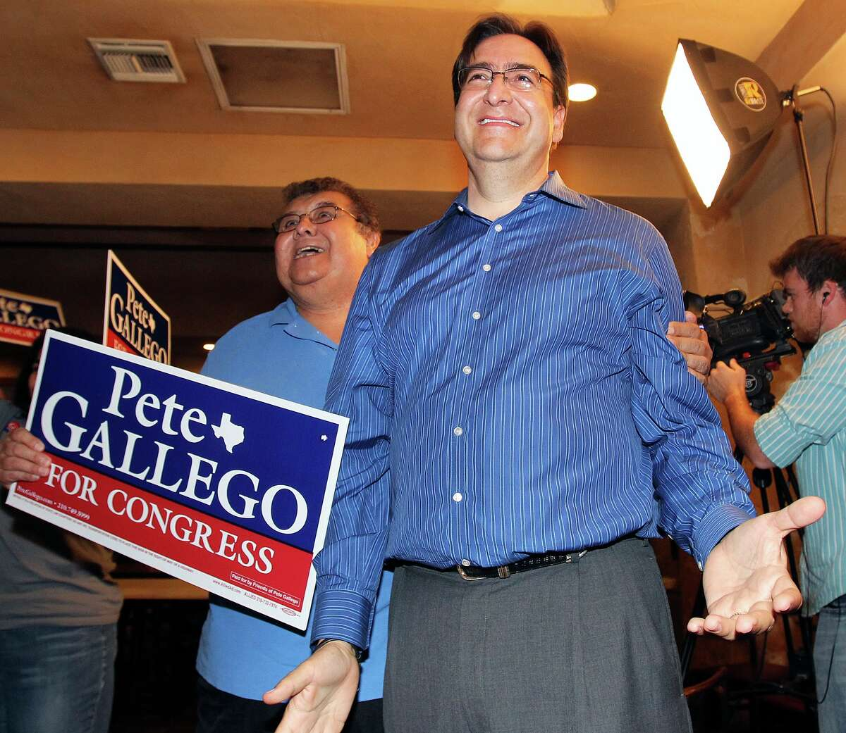 State Rep. Pete Gallego, D-Alpine, reacts to a televised report of a large lead late in the night on Tuesday.