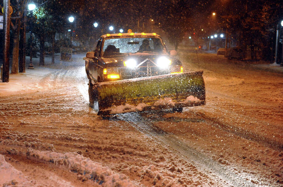 A truck with a plow makes its way down Fairfield Avenue in the Black Rock section of Bridgeport, Conn. on Wednesday November 7, 2012. Photo: Christian Abraham / Connecticut Post