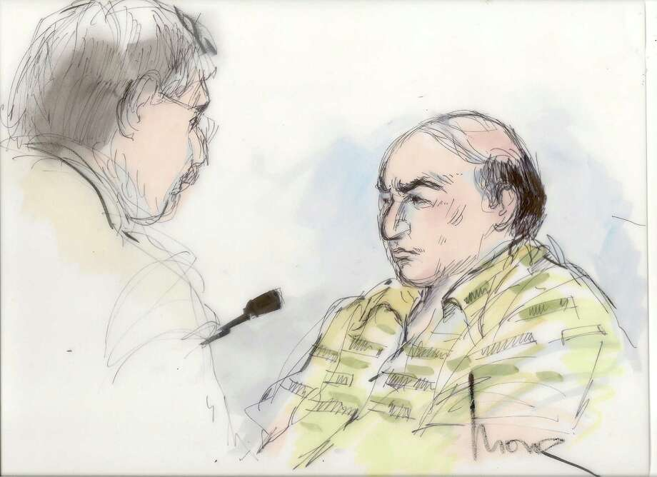 File-This Sept. 27, 2012 file courtroom sketch shows shows Mark Basseley Youssef talking with his attorney Steven Seiden, left, in court in Los Angeles. Youssef received a one-year sentence Wednesday Nov. 7, 2012, in federal prison for parole violation.  (AP Photo/Mona Shafer Edwards, file) Photo: Mona Shafer Edwards
