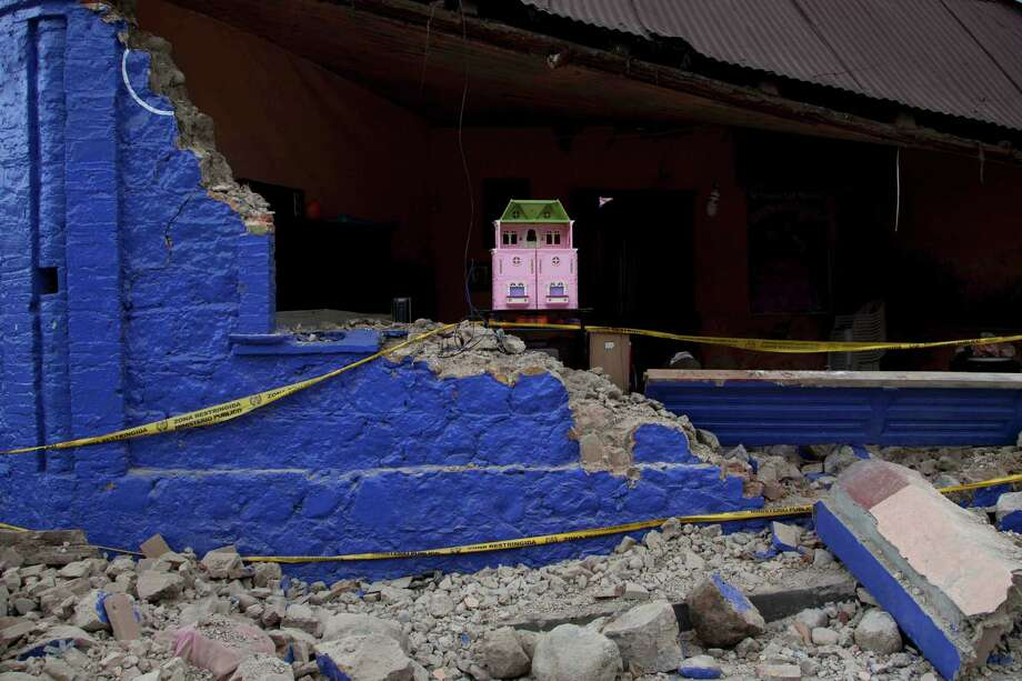A dollhouse is seen inside a damaged house after a magnitude 7.4 earthquake that struck in San Marcos, Guatemala, Wednesday, Nov. 7, 2012. The mountain village, some 80 miles (130 kilometers) from the epicenter, suffered much of the damage with some 30 homes collapsing in its center. There are three confirmed dead and many missing after the strongest earthquake to hit Guatemala since a deadly 1976 quake that killed 23,000. (AP Photo/Moises Castillo) Photo: Moises Castillo
