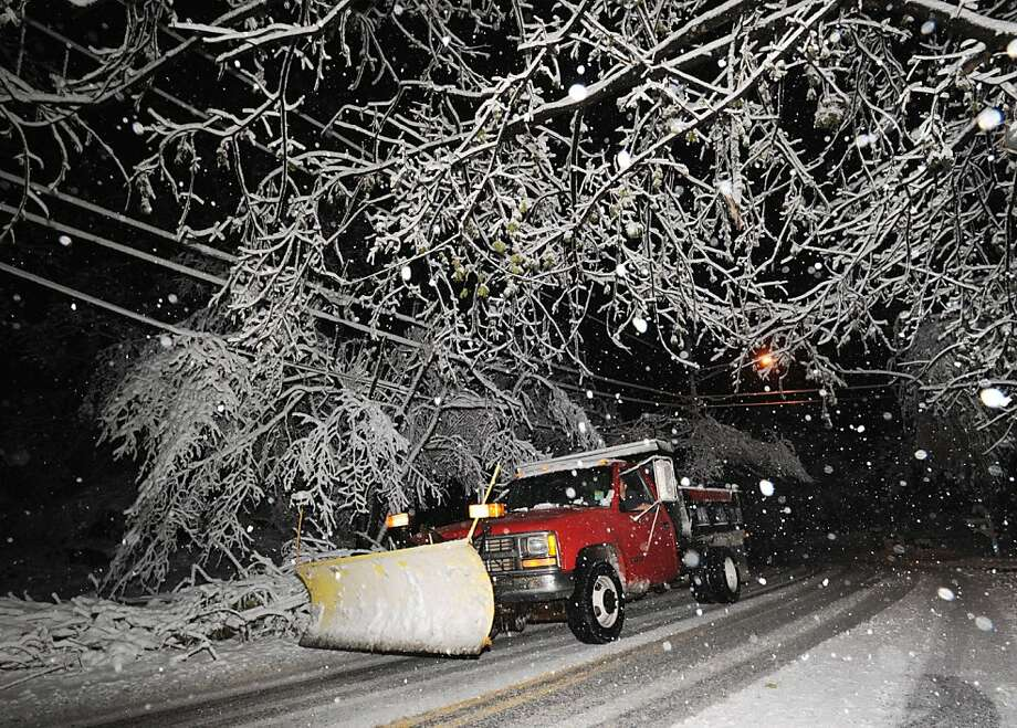 A plow truck makes its way through a snow covered Bruce Park Drive during the nor'easter that hit Greenwich, Wednesday night, November 7, 2012. Photo: Bob Luckey, Connecticut Post
