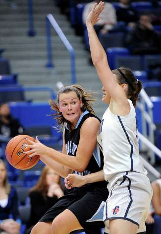Holy Family's Reagan Jewell, left, is guarded by Connecticut's Kelly Faris during the first half of an exhibition NCAA college basketball game in Hartford, Conn., on Wednesday, Nov. 7, 2012. (AP Photo/Fred Beckham) Photo: Fred Beckham, Associated Press / FR153656 AP