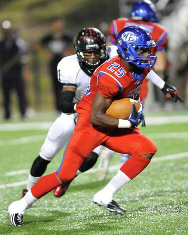 "West Brook Bruin #25, Justin Hervey, right, heads downfield with a Titan defender right on his heels. The West Brook Bruins hosted the Port Arthur Memorial Titans football team Friday night at the Carrol A.""Butch"" Thomas Educational Support Center Beaumont.  This was a District 21-5A game. At the half, the score was the Titans 35, the Bruins 10.  Dave Ryan/The Enterprise Photo: Dave Ryan"