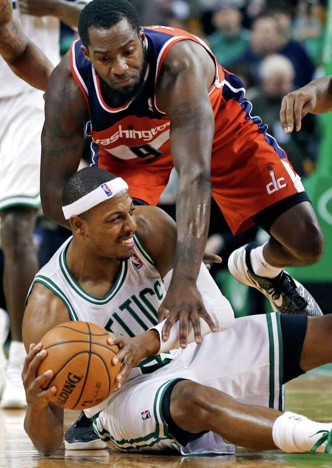 Boston Celtics forward Paul Pierce protects the ball on the floor against Washington Wizards forward Martell Webster (9) after recovering a loose ball during the second half of an NBA basketball game in Boston, Wednesday, Nov. 7, 2012. The Celtics won 100-94 in overtime. (AP Photo/Elise Amendola), Photo: Elise Amendola