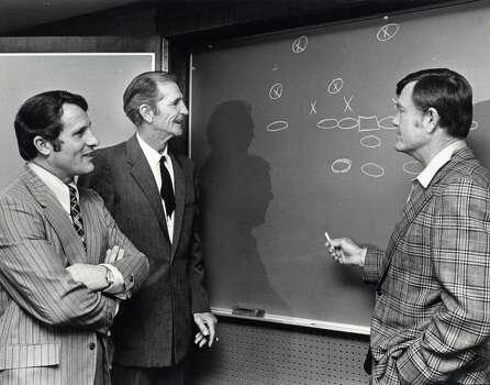Texas A&M coach Emory Bellard (left), former TCU and NFL quarterback Sammy Baugh and UT coach Darrell Royal rehash the wishbone in 1974. Photo: David Nance, HC Staff / Houston Chronicle