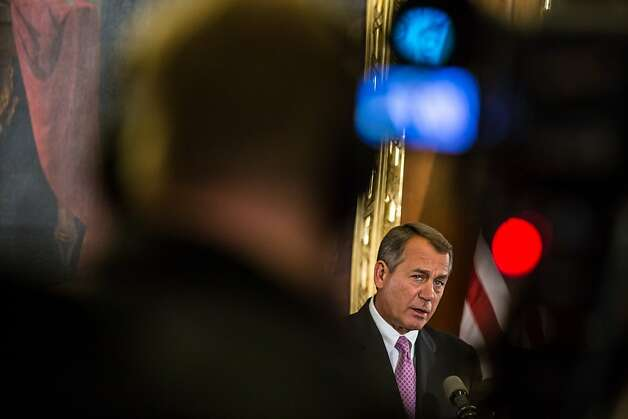 House Speaker John Boehner calls on President Obama to work with House Republicans to avoid looming fiscal crisis. Photo: Brendan Hoffman, Getty Images