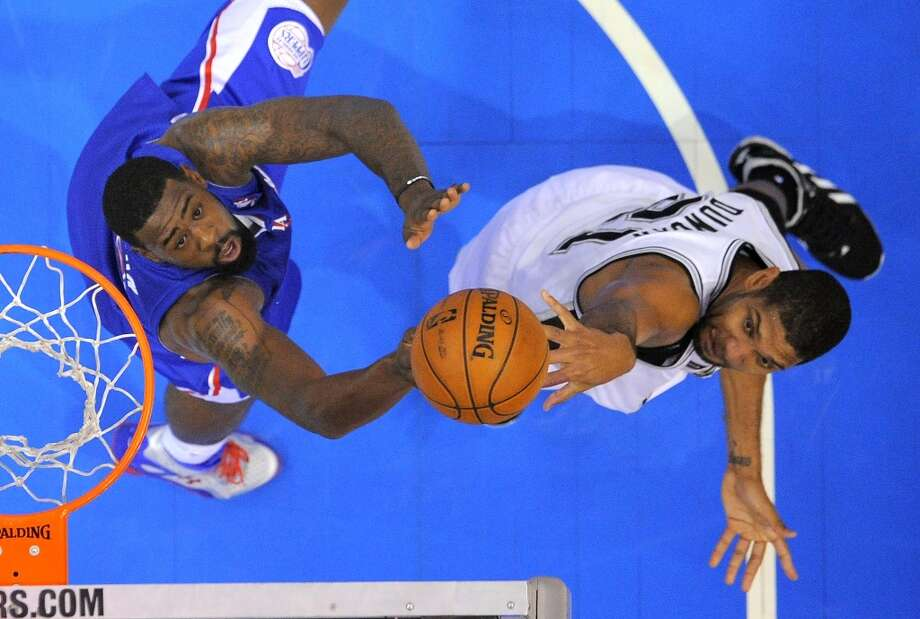 San Antonio Spurs forward Tim Duncan, right, shoots as Los Angeles Clippers center DeAndre Jordan defends during the first half of their NBA basketball game, Wednesday, Nov. 7, 2012, in Los Angeles. (AP Photo/Mark J. Terrill) (Associated Press)
