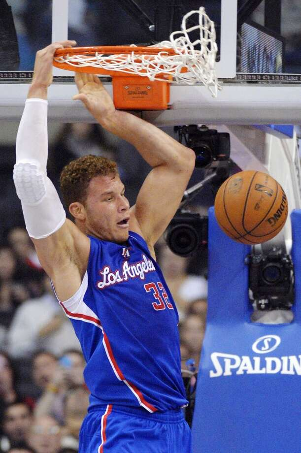 Los Angeles Clippers forward Blake Griffin dunks during the first half of their NBA basketball game against the San Antonio Spurs, Wednesday, Nov. 7, 2012, in Los Angeles. (AP Photo/Mark J. Terrill) (Associated Press)