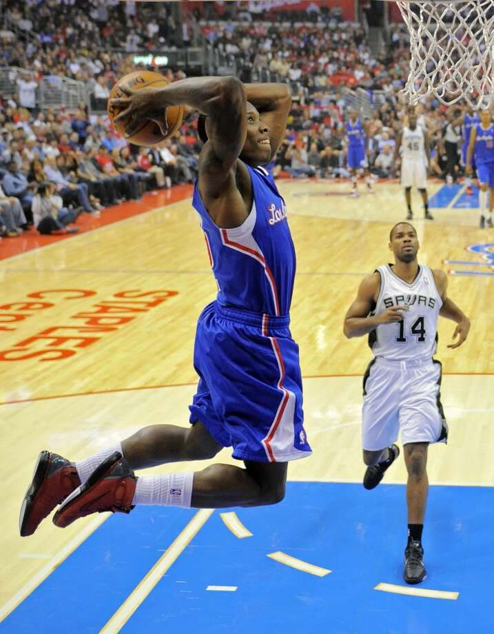 Los Angeles Clippers guard Eric Bledsoe, left, goes up for a dunk as San Antonio Spurs guard Gary Neal watches during the first half of their NBA basketball game, Wednesday, Nov. 7, 2012, in Los Angeles. (AP Photo/Mark J. Terrill) (Associated Press)