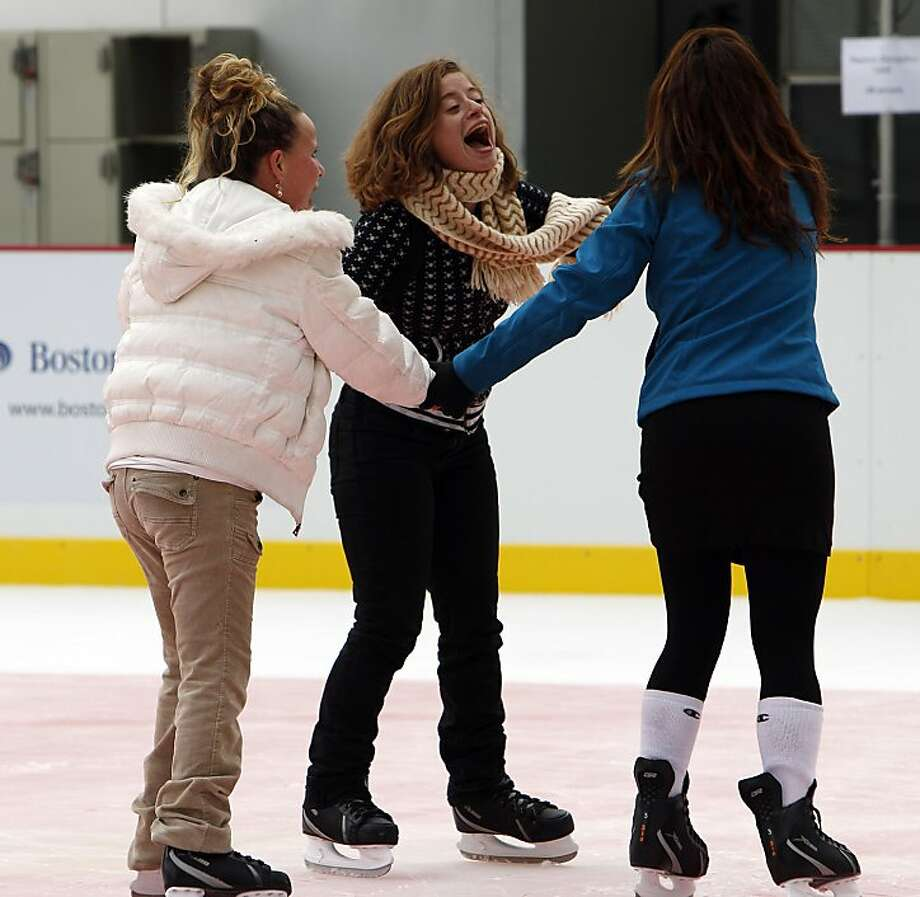 L-R, Rachel Rodriguez, Johanna Marchese, and Rozie Firoozabadi, laugh as they skate on the Holiday Ice Rink at the Embarcardero which opened on Wednesday, November 7, 2012, at Justin Herman Plaza in San Francisco, Calif. Photo: Carlos Avila Gonzalez, The Chronicle