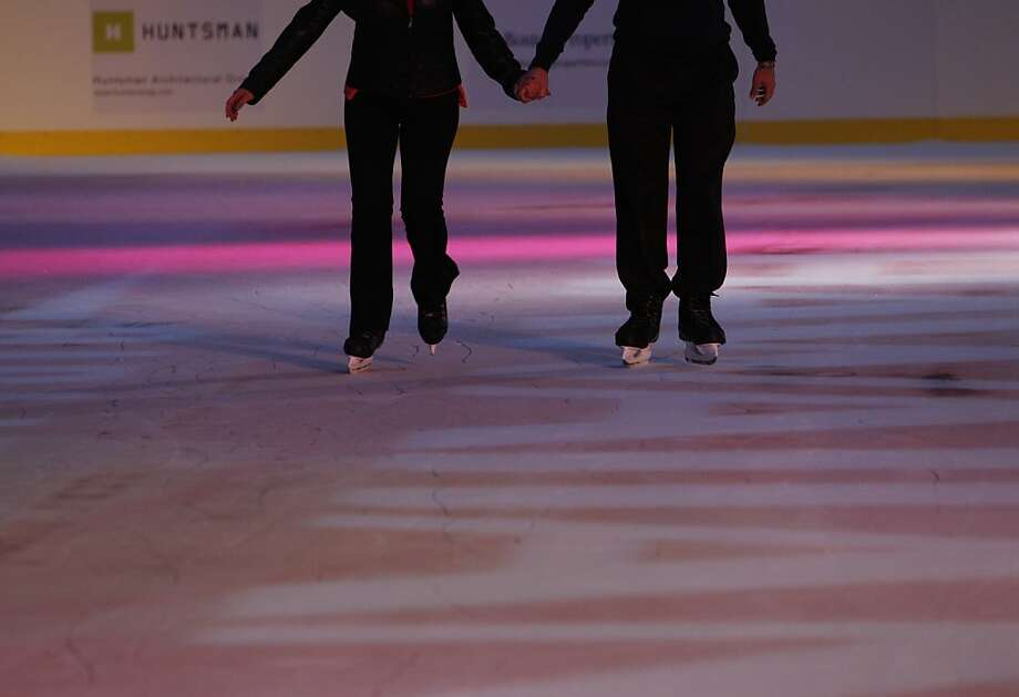 Two co-workers from the Embarcadero hold hands for stability as they skate at the Holiday Ice Rink which opened on Wednesday, November 7, 2012, at Justin Herman Plaza in San Francisco, Calif. Photo: Carlos Avila Gonzalez, The Chronicle
