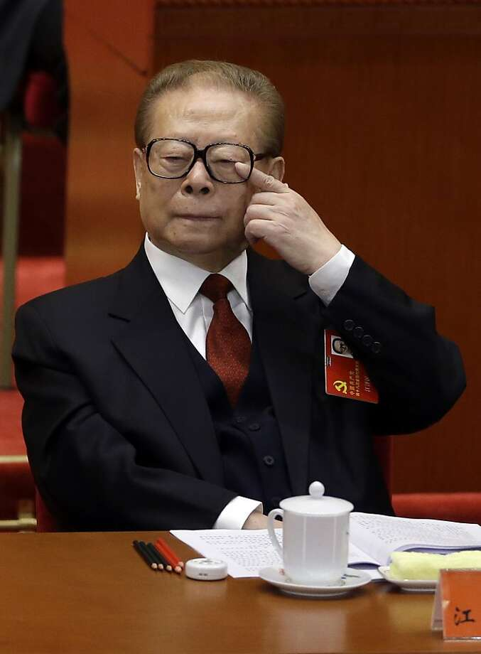 Former Chinese President Jiang Zemin reacts during the opening session of the 18th Communist Party Congress held at the Great Hall of the People in Beijing, China, Thursday, Nov. 8, 2012. Preparing to hand over power after a decade in office, China's President Hu Jintao called Thursday for sterner measures to combat official corruption that has stoked public anger while urging the Communist Party to maintain firm political control. (AP Photo/Ng Han Guan) Photo: Ng Han Guan, Associated Press