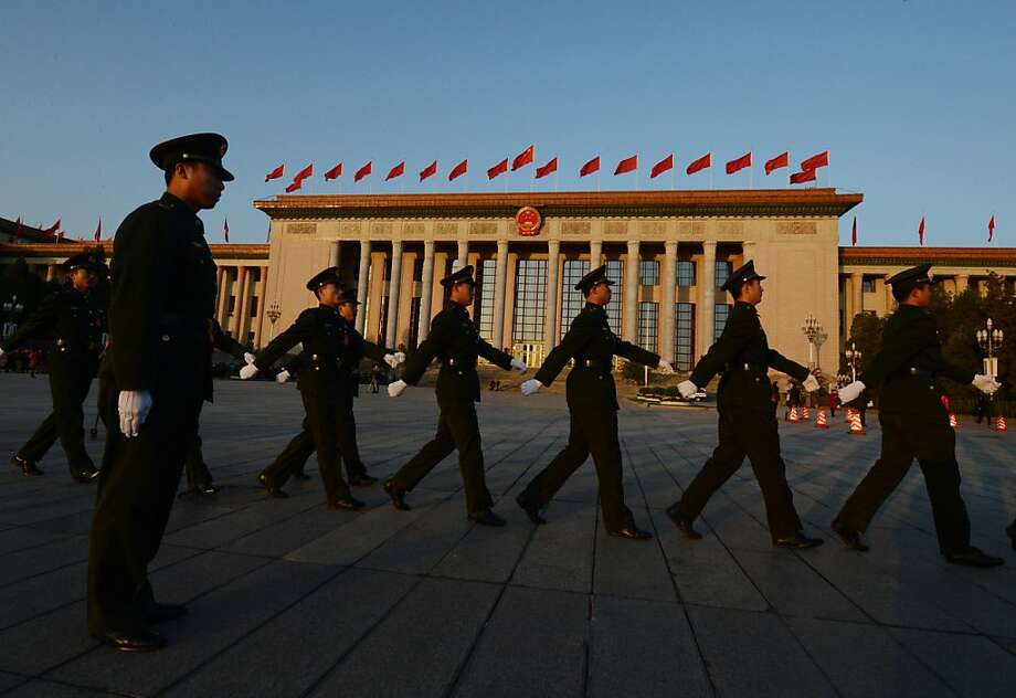 Chinese paramilitary police march outside the opening session of the Chinese Communist Party's five-yearly Congress at the Great Hall of the People in Beijing on November 8, 2012.  The week-long congress, held every five years, will end with a transition of power to Vice President Xi Jinping, who will govern for the coming decade amid growing pressure for reform of the communist regime's iron-clad grip on power.           AFP PHOTO/Mark RALSTONMARK RALSTON/AFP/Getty Images Photo: Mark Ralston, AFP/Getty Images
