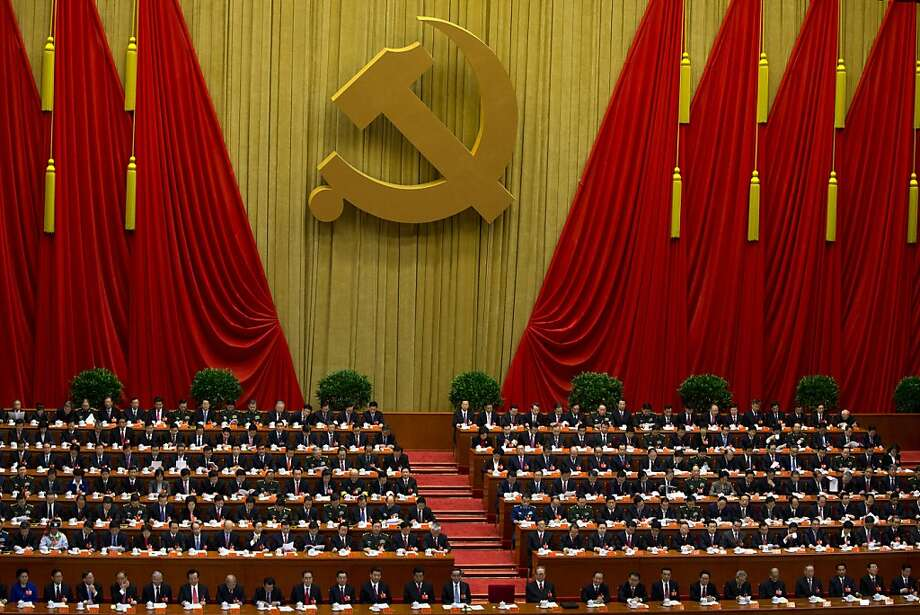Chinese Communist Party leaders attend  the opening session of 18th Communist Party Congress, while Hu Jintao, no in the picture, Chinese president and current Chinese Communist Party general secretary, reads a work report, whose seat is seen empty in the center of front row, at the Great Hall of the People in Beijing, China, Thursday, Nov. 8, 2012. Preparing to hand over power after a decade in office, China's President Hu Jintao called Thursday for sterner measures to combat official corruption that has stoked public anger while urging the Communist Party to maintain firm political control.  (AP Photo/Alexander F. Yuan) Photo: Alexander F. Yuan, Associated Press