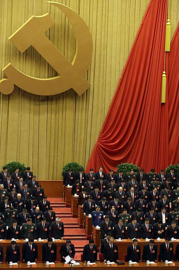 China's communist leaders bow in silence in remembrance of late leaders during the opening session of the 18th Communist Party Congress held at the Great Hall of the People in Beijing, China, Thursday, Nov. 8, 2012. China's ruling Communist Party opened a congress Thursday to usher in a new group of younger leaders faced with the challenging tasks of righting a flagging economy and meeting public calls for better government. (AP Photo/Ng Han Guan) Photo: Ng Han Guan, Associated Press