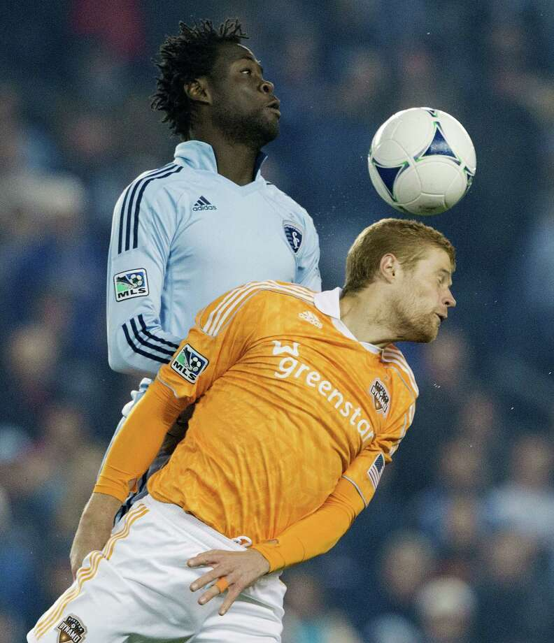 Sporting KC forward Kei Kamara (23) and Houston Dynamo defender Andre Hainault (31) battle over a header in the first half during Wednesday's MLS playoff soccer game on November 7, 2012, at Livestrong Sporting Park in Kansas City, Ks. John Sleezer/The Kansas City Star Photo: JOHN SLEEZER, The Kansas City Star