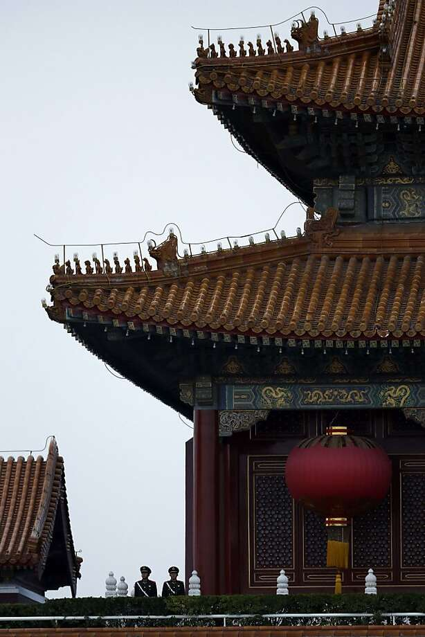 Chinese paramilitary policemen patrol Tianamen Gate in Beijing, China, Wednesday, Nov. 7, 2012. The Chinese Communist Party's 18th National Congress is scheduled to begin Nov. 8 in the Chinese capital. In addition to selecting members of the leading party bodies, the 2770 delegates hear and deliberate over the work of the party over the past five years, a party discipline report and revisions to the party constitution. (AP Photo/Ng Han Guan) Photo: Ng Han Guan, Associated Press