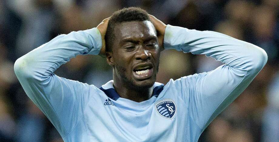 Sporting KC forward C.J. Sapong (17) reacts to missing a shot on goal in the second half during Wednesday's MLS playoff soccer game against the Houston Dynamo on November 7, 2012, at Livestrong Sporting Park in Kansas City, Ks. John Sleezer/The Kansas City Star Photo: JOHN SLEEZER, The Kansas City Star