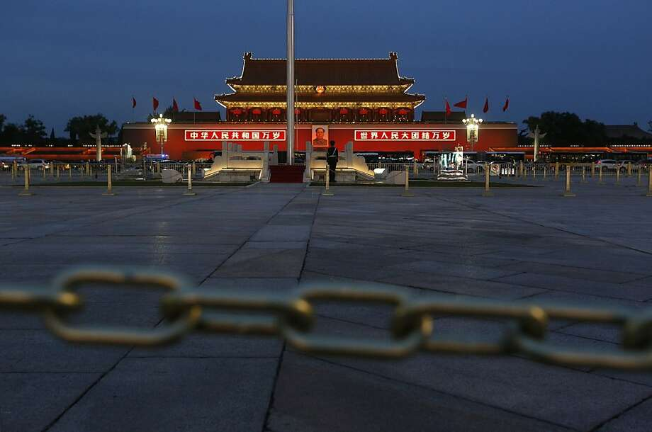 A Chinese paramilitary policeman stands guard at Tiananmen Square in Beijing, China Wednesday, Nov. 7, 2012.  The Chinese Communist Party's 18th National Congress is scheduled to begin Nov. 8 in the Chinese capital. The once-a-decade event will install new leadership to run the world's second largest economy and newly assertive global power. (AP Photo/Vincent Yu) Photo: Vincent Yu, Associated Press
