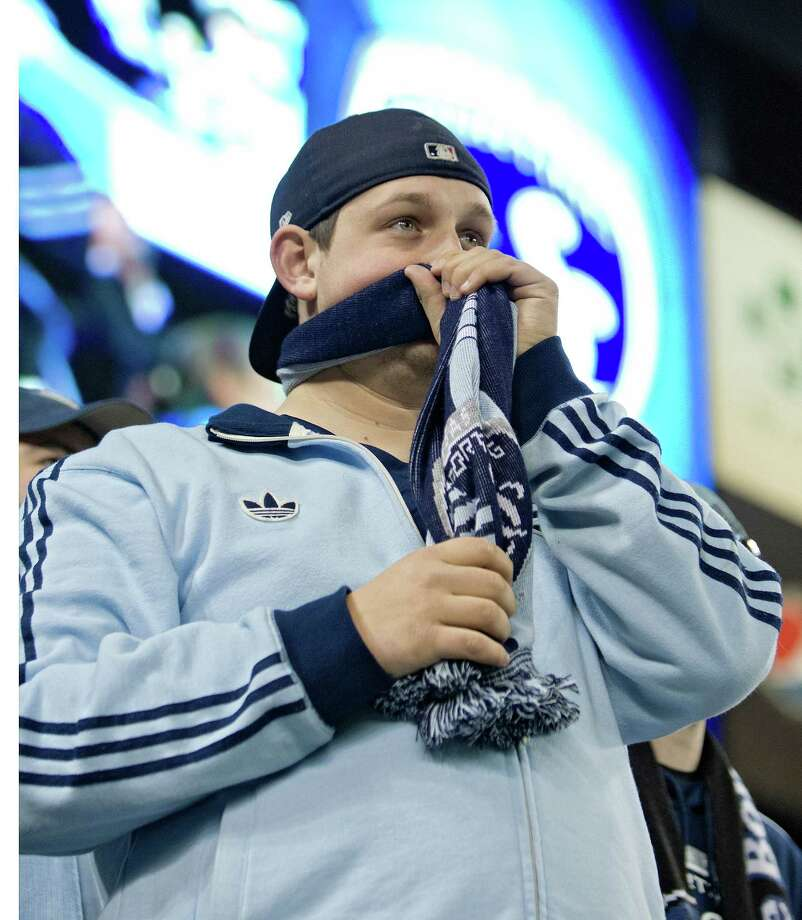 Sporting KC fan Ryan Freerksen, from Des Moines, Ia, chews on his scarf in the closing minutes of the teams loss in aggregate scoring to the Houston Dynamo during Wednesday's MLS playoff soccer game on November 7, 2012, at Livestrong Sporting Park in Kansas City, Ks. John Sleezer/The Kansas City Star Photo: JOHN SLEEZER, The Kansas City Star
