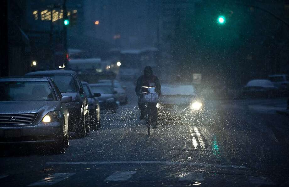 NEW YORK, NY - NOVEMBER 07: A man rides his bike in downtown Manhattan during a Nor'easter, also known as a northeaster storm November 7, 2012 in New York City.  The storm will bring heavy winds, rain and sleet, and could potentially re-flood Battery Park and downtown Manhattan, areas that were affected by Superstorm Sandy. (Photo by Allison Joyce/Getty Images) Photo: Allison Joyce, Getty Images