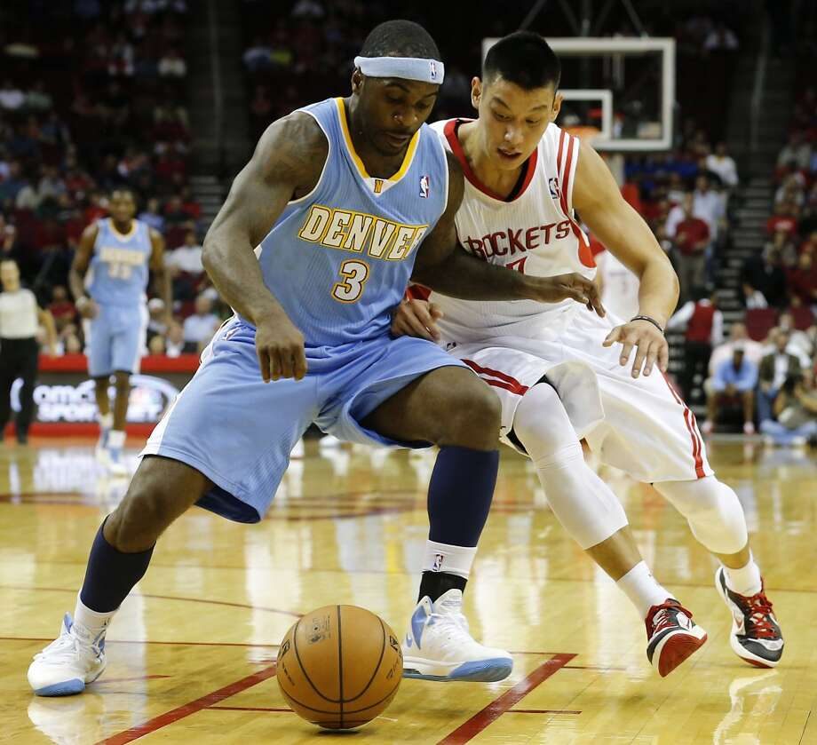 Ty Lawson left, and Jeremy Lin chase a loose ball. (James Nielsen / Houston Chronicle)