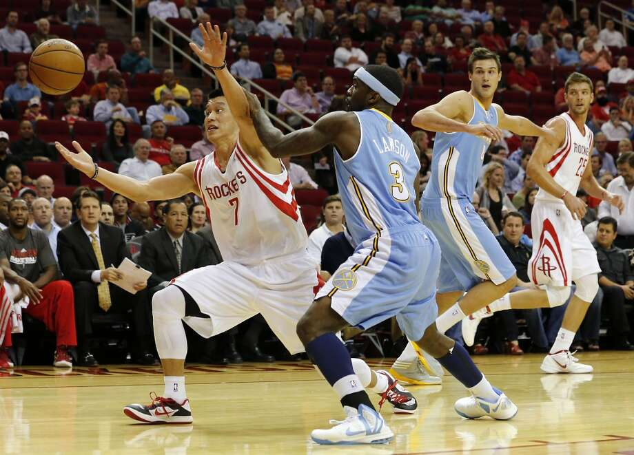 The Rockets Jeremy Lin left, and the Nuggets Ty Lawson 2nd from left, chase a loose ball. (James Nielsen / Houston Chronicle)