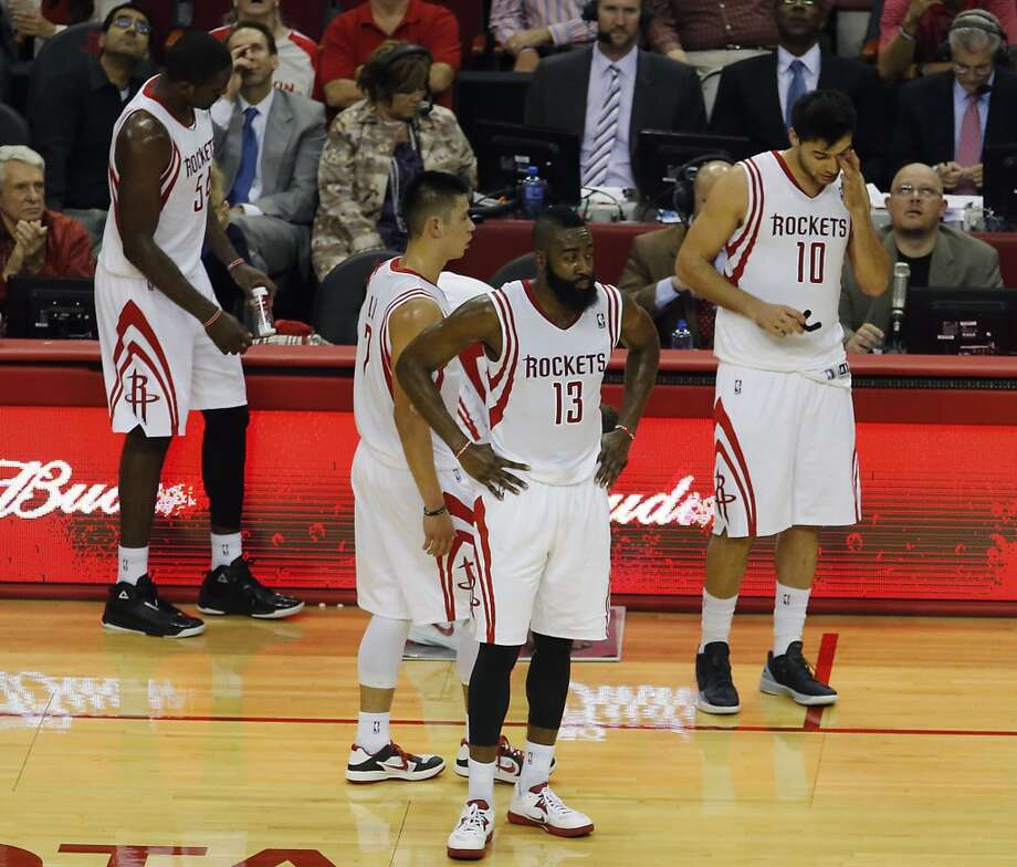 Patrick Patterson left, Jeremy Lin, James Harden and Carlos Delfino walk back to the court after a time out. (James Nielsen / Houston Chronicle)