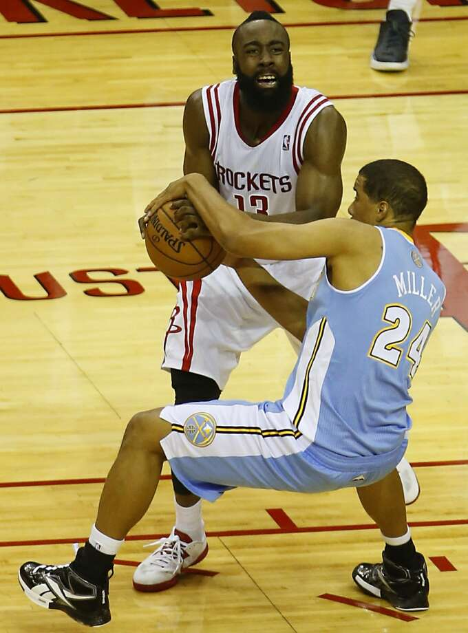 James Harden left, and the Nuggets Andre Miller wrestle for the ball. (James Nielsen / Houston Chronicle)