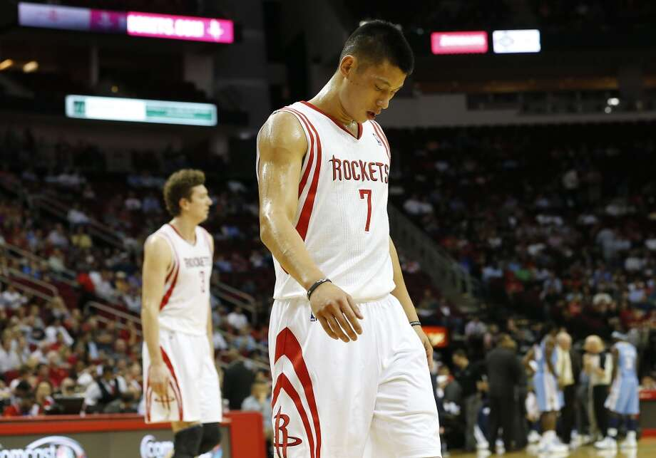 Lin hangs his head in during the fourth quarter of a loss to the Nuggets. (James Nielsen / Houston Chronicle)