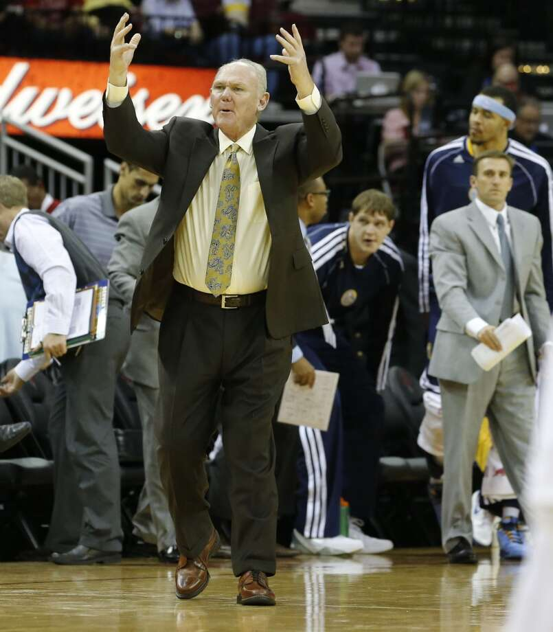 Nuggets coach George Karl reacts to a whistle. (James Nielsen / Houston Chronicle)