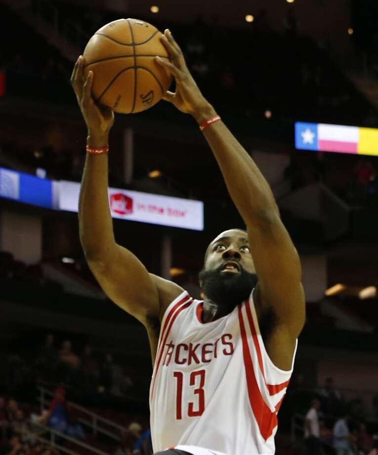 James Harden drives to the basket. (James Nielsen / Houston Chronicle)