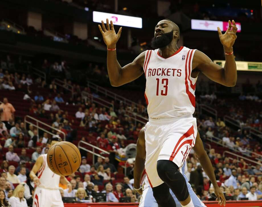 James Harden is stripped of the ball. (James Nielsen / Houston Chronicle)