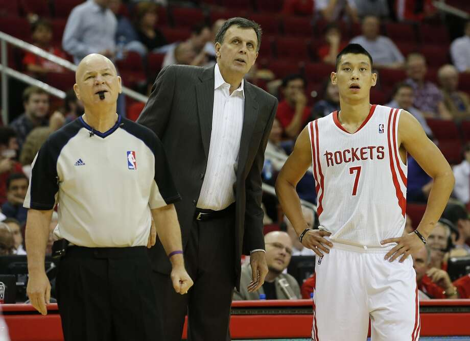NBA Official Joe Crawford left, the Rockets head coach Kevin McHale center and Jeremy Lin right, stand on the sideline.  (James Nielsen / Houston Chronicle)