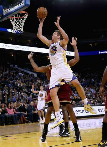 OAKLAND, CA - NOVEMBER 07: David Lee #10 of the Golden State Warriors shoots over Samardo Samuels #24 of the Cleveland Cavaliers at Oracle Arena on November 7, 2012 in Oakland, California.  NOTE TO USER: User expressly acknowledges and agrees that, by downloading and or using this photograph, User is consenting to the terms and conditions of the Getty Images License Agreement.  (Photo by Ezra Shaw/Getty Images) Photo: Ezra Shaw, Getty Images