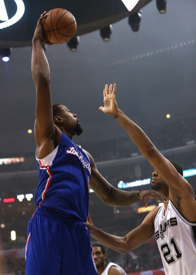 LOS ANGELES, CA - NOVEMBER 07:  DeAndre Jordan #6 of the Los Angeles Clippers shoots over Tim Duncan #21 of the San Antonio Spurs at Staples Center on November 7, 2012 in Los Angeles, California.  NOTE TO USER: User expressly acknowledges and agrees that, by downloading and or using this photograph, User is consenting to the terms and conditions of the Getty Images License Agreement.  (Photo by Stephen Dunn/Getty Images) (Getty Images)