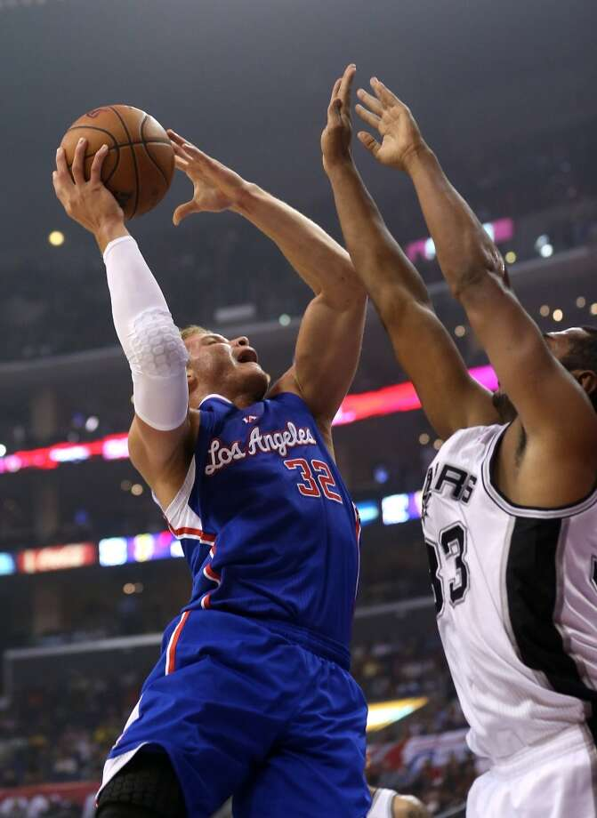 LOS ANGELES, CA - NOVEMBER 07:  Blake Griffin #32 of the Los Angeles Clippers shoots over Boris Diaw #33 of the San Antonio Spurs at Staples Center on November 7, 2012 in Los Angeles, California.  NOTE TO USER: User expressly acknowledges and agrees that, by downloading and or using this photograph, User is consenting to the terms and conditions of the Getty Images License Agreement.  (Photo by Stephen Dunn/Getty Images) (Getty Images)