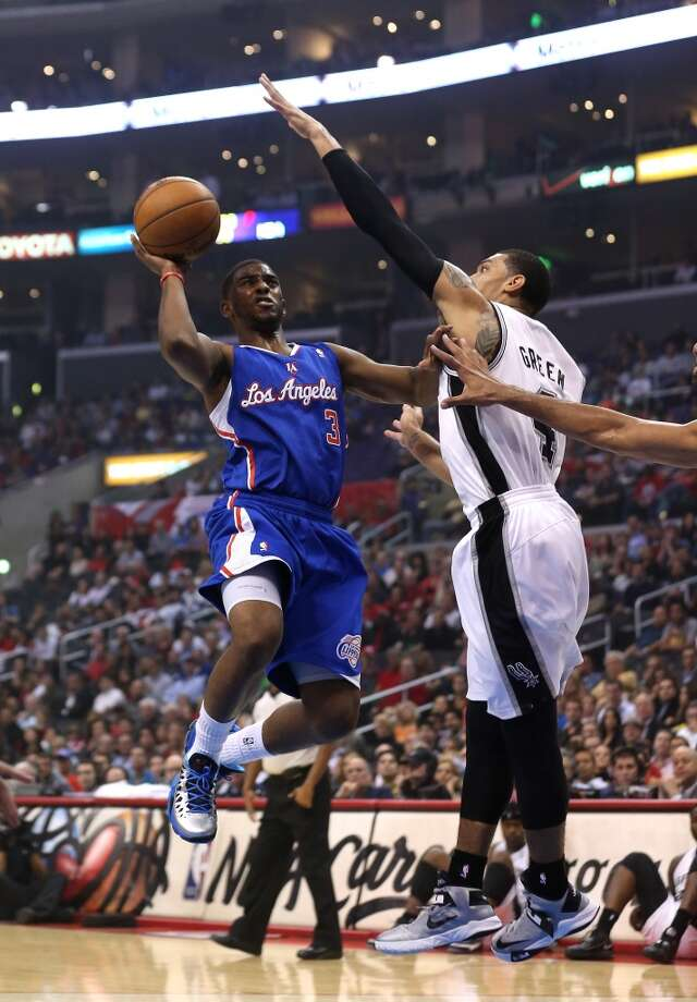 LOS ANGELES, CA - NOVEMBER 07:  Chris Paul #3 of the Los Angeles Clippers goes up for a shot against Danny Green #4 of the San Antonio Spurs at Staples Center on November 7, 2012 in Los Angeles, California.  NOTE TO USER: User expressly acknowledges and agrees that, by downloading and or using this photograph, User is consenting to the terms and conditions of the Getty Images License Agreement.  (Photo by Stephen Dunn/Getty Images) (Getty Images)