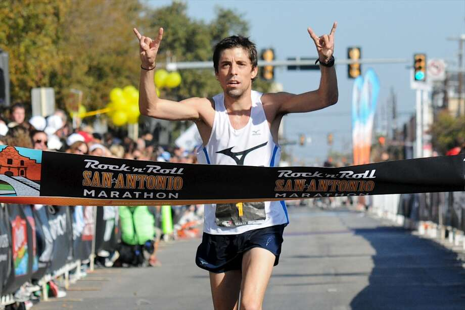 David Fuentes, a former standout in cross country at Boerne High School, crosses the finish line in first place during the San Antonio Rock 'n' Roll Marathon on Nov. 13, 2011. (San Antonio Express-News)