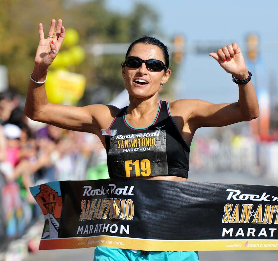 Liza Hunter-Galvan crosses the finish line in the San Antonio Rock 'n' Roll Marathon on Nov. 13, 2011. (San Antonio Express-News)