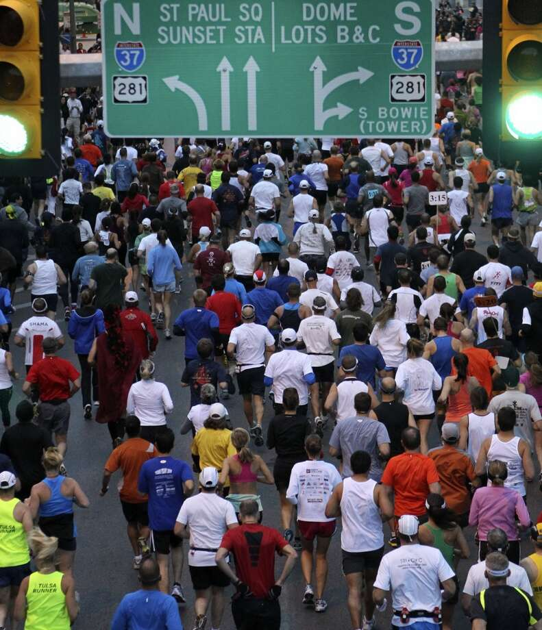 Runners head east on Market Sunday, Nov. 14, 2010, at the start of the Rock 'n' Roll San Antonio Marathon and 1/2. (SAN ANTONIO EXPRESS-NEWS)
