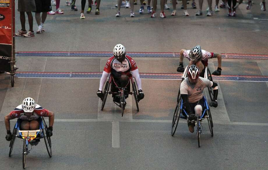 Wheelchair participants take off Sunday at the starting line during the Rock 'n' Roll San Antonio Marathon and Half Sunday, Nov. 14, 2010. (SAN ANTONIO EXPRESS-NEWS)