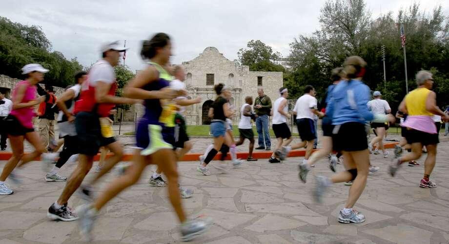 Runners in the 2010 Rock 'n' Roll San Antonio Marathon and Half go past the Alamo Sunday, Nov. 14. (SAN ANTONIO EXPRESS-NEWS)