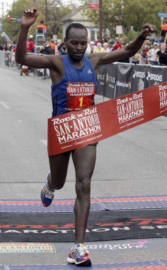 Edward Tabut of Kenya wins the 2010 Rock 'n' Roll San Antonio Marathon Sunday, Nov. 14, 2010, with a time of 2:17:04. (SAN ANTONIO EXPRESS-NEWS)